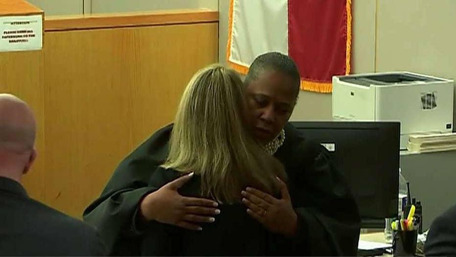 Judge defends hugging Amber Guyger after murder trial