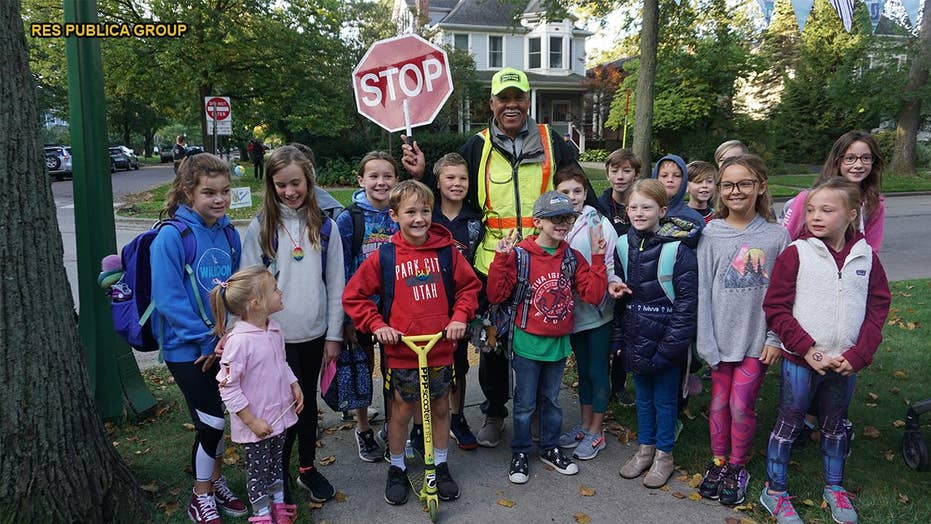 Community surprises beloved crossing guard for 80th birthday