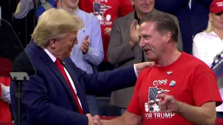 Trump honors police officers at Minnesota rally