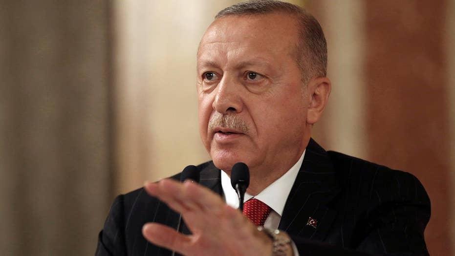 Turkish President Erdogan defends Syria intrusion as thousands flee