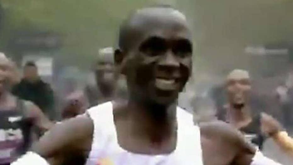 Kenyan curtain breaks two-hour marathon barrier
