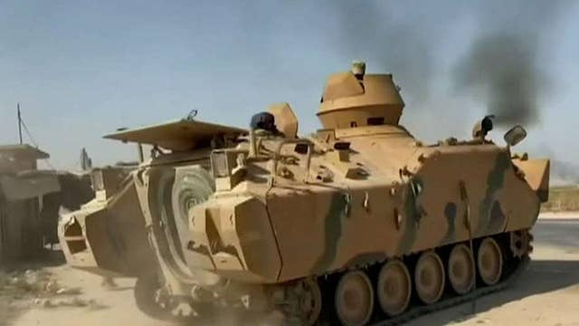 Kurdish forces partner with Syrian army to defend against Turkey