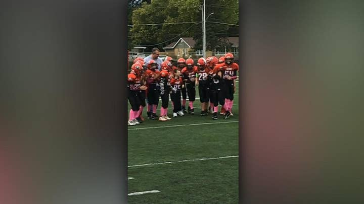 7-year-old boy with cerebral palsy becomes honorary football captain for a day