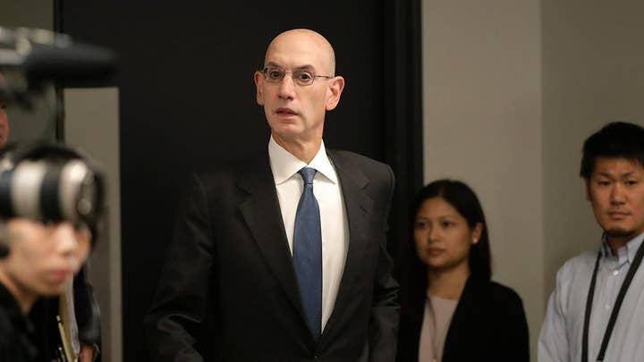 Media dunk NBA over China