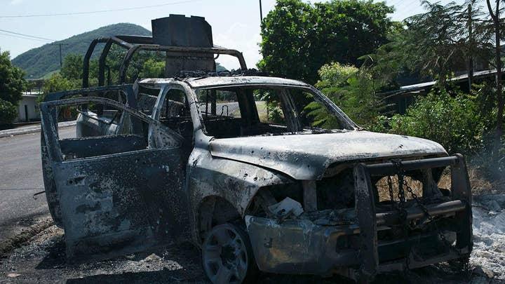 Mexican cartel ambushes police convoy, kills 13 officers