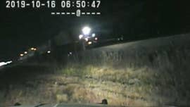 Video shows Utah trooper risk his life to save driver stuck on train tracks
