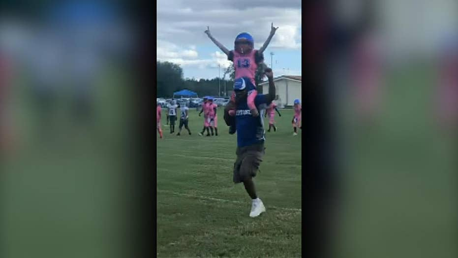 Child with heart disease scores first touchdown
