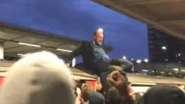 London rush-hour commuters yank climate-change protesters from roofs of trains