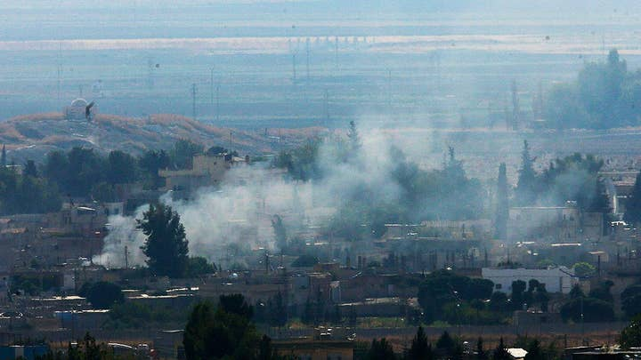 Shelling and smoke reported near Syria-Turkey border