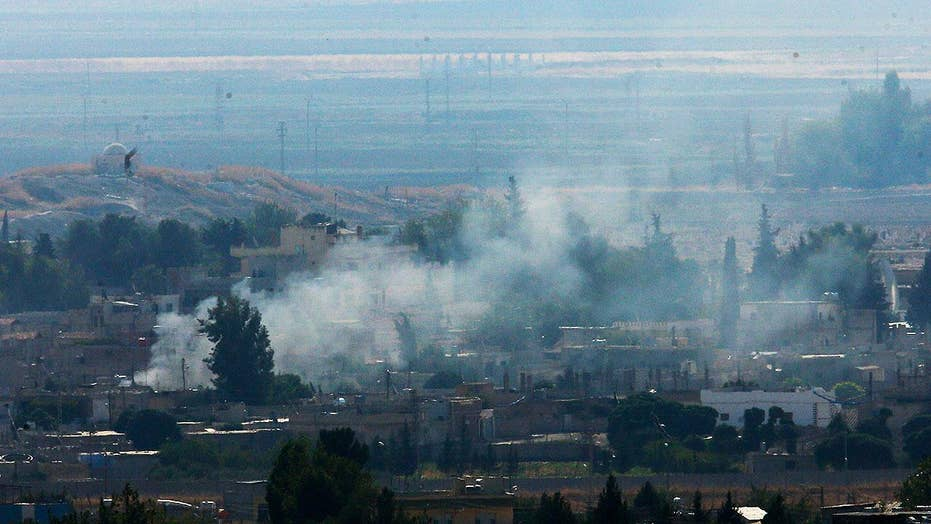 Shelling and smoke reported near Syria-Turkey border