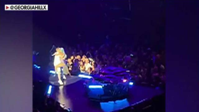 Lady Gaga falls off stage during concert