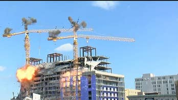 Implosion of unstable cranes at NOLA Hard Rock collapse site