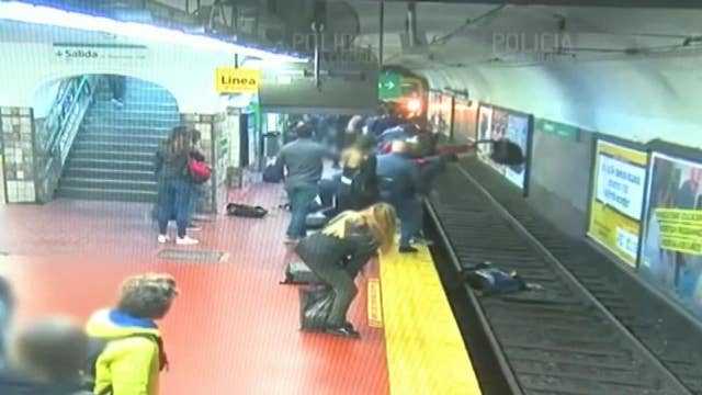 Commuters help save woman who fell onto Buenos Aires subway tracks