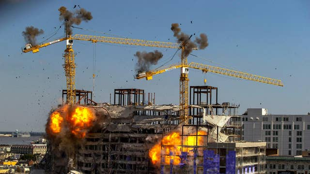 Controlled demolition takes place at New Orleans construction site