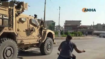Kurdish protesters throw rocks, potatoes at departing US troops