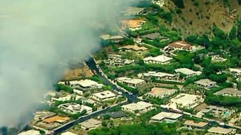 Brush fire burns near celebrity homes in Southern California
