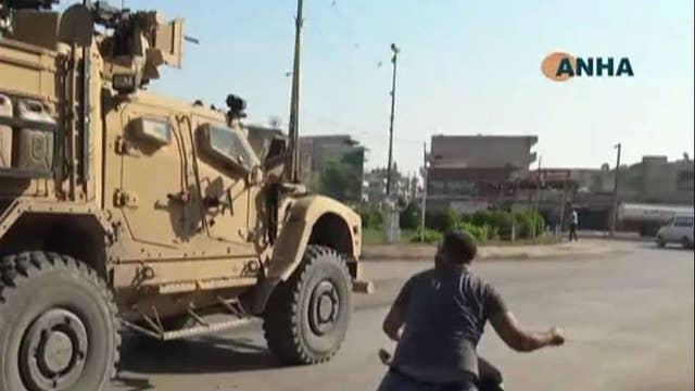 Kurdish protesters throw rocks, potatoes at departing US troops
