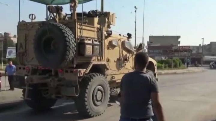 Departing US forces pelted by angry Kurds in Syria