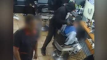 New York man robbed at gunpoint during haircut, video shows