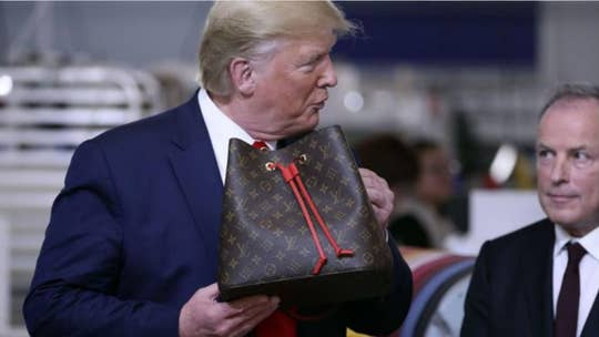 Louis Vuitton designer blast Trump following ribbon cutting ceremony