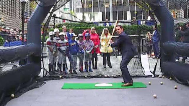 'Fox & Friends' hosts take a swing to celebrate the start of the World Series