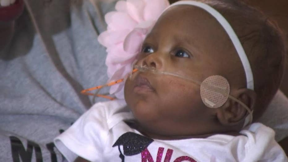 Baby born weighing less than one pound released from Arizona hospital after nearly five months