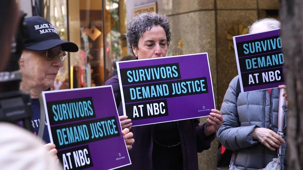 Protesters take their anger at NBC to 30 Rock's door, demand answers