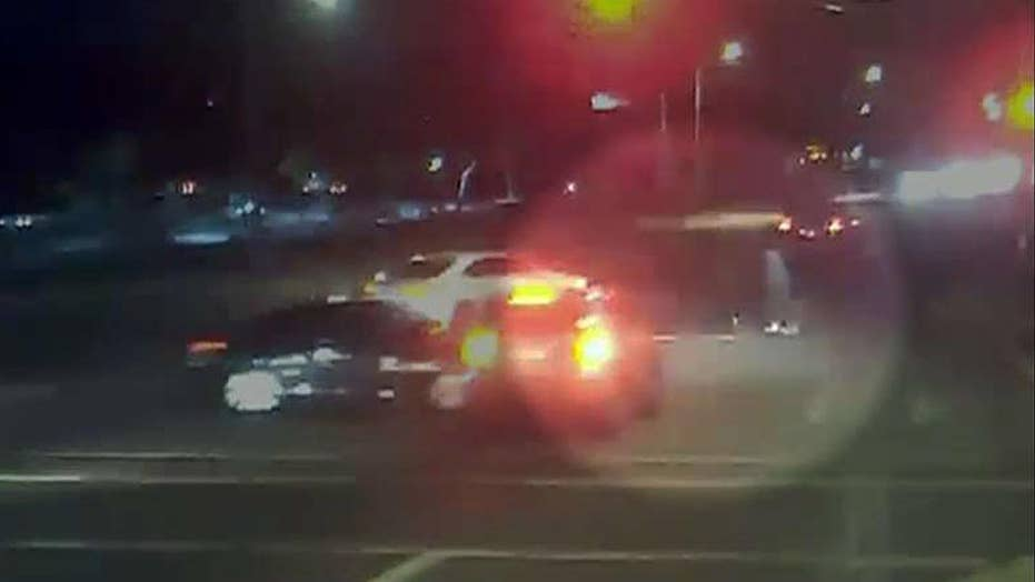 Arizona driver runs red light, narrowly misses couple with a stroller