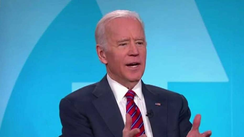 Biden drops opposition to super PAC fundraising