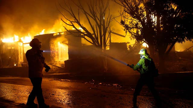 Wind-driven wildfires in Northern and Southern California destroy homes, force evacuations