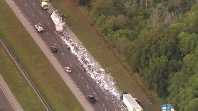 Truck crash leaves mess of mail along major Florida highway