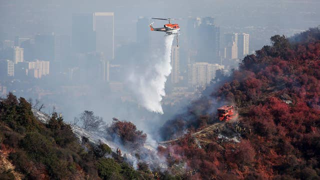 Fire crews race to tamp down Getty Fire hotspots before Santa Ana winds return to Los Angeles
