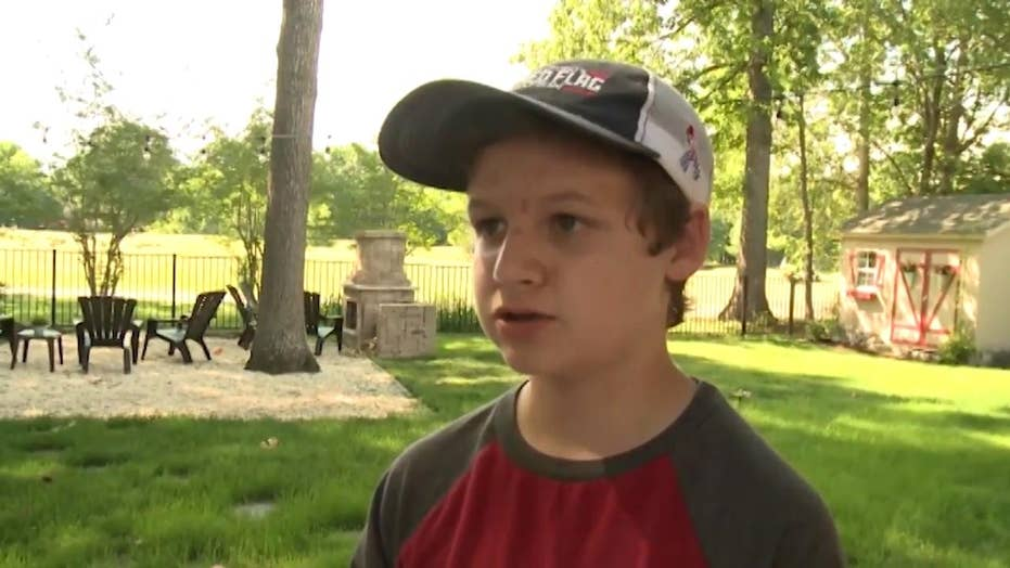 14 year old son of service member covers neighborhood in American flags