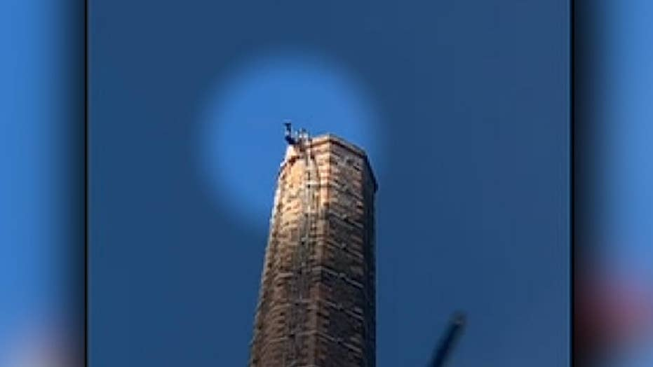 Man stuck on top of 290-foot tall smokestack dies
