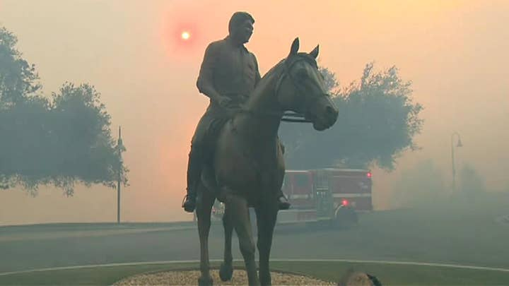 Fire crews work to protect the Ronald Reagan Presidential Library from fast-moving brushfire