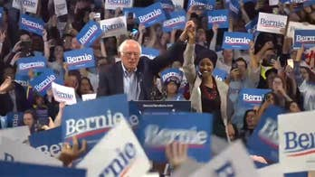 Ilhan Omar, at Bernie Sanders rally, calls for 'mass movement of the working class' amid 'Lock him up' chants