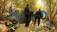Cleanup begins in homeless camp ripe for wildfires in California's San Fernando Valley