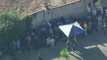 Crowds flock to Chris Brown's California mansion as singer holds yard sale
