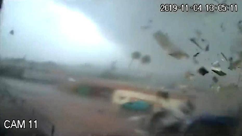 Surveillance cameras capture a tornado tear across a factory in Greece