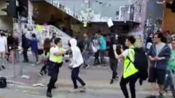 Hong Kong police harden response to pro-democracy protests