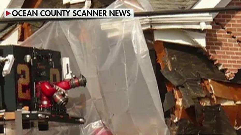 Two killed after red Porsche crashes into second floor of building