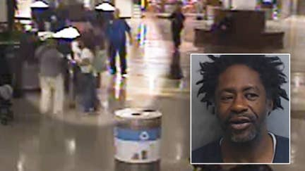 Panhandler accused of assaulting traveler at Atlanta airport