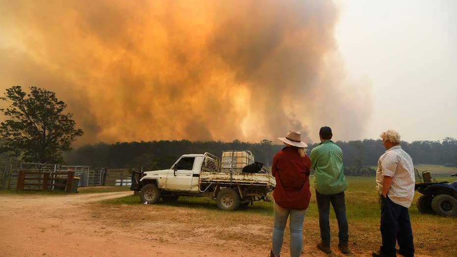 Australian firefighters struggle to fast-moving flames as bushfires rage out of control