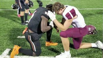 High school football rivals pray together for mother battling cancer