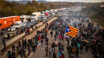 Catalan protesters snarl traffic, burn barricades in major Spain highway