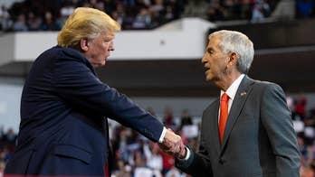 Trump weighs in on tight Louisiana gubernatorial race as polls open