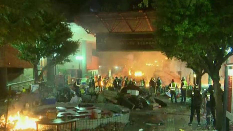 Hong Kong protesters set fire to polytechnic university entrance as police attempt to move in
