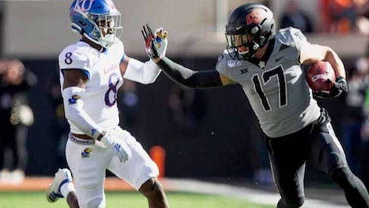 Oklahoma State football team honors veterans with military-style uniforms