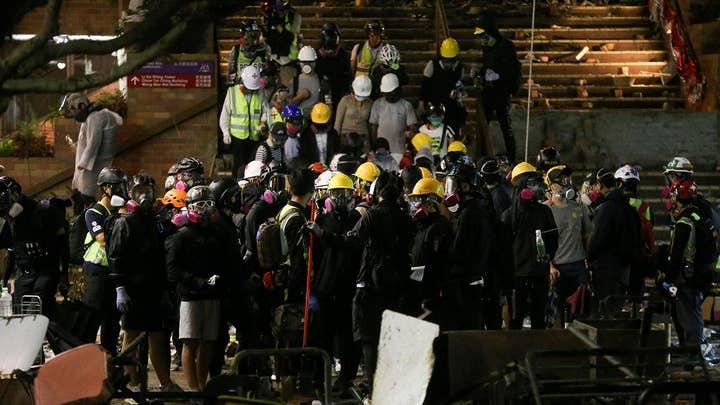 Tensions between Hong Kong police and protesters escalates