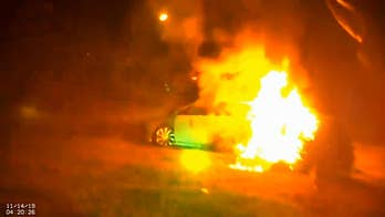 Woman cut out of burning car